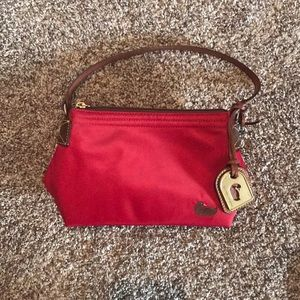 Small red Dooney and Bourke purse